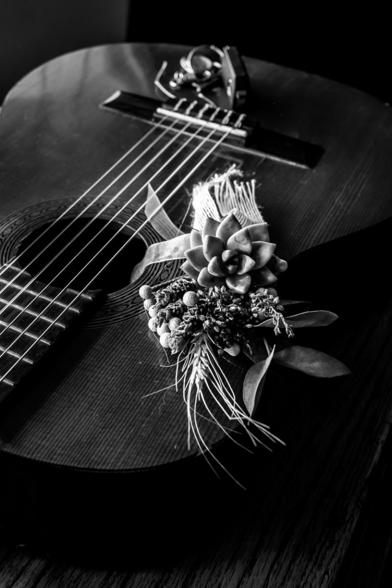 The groom's wedding details photographed with a guitar