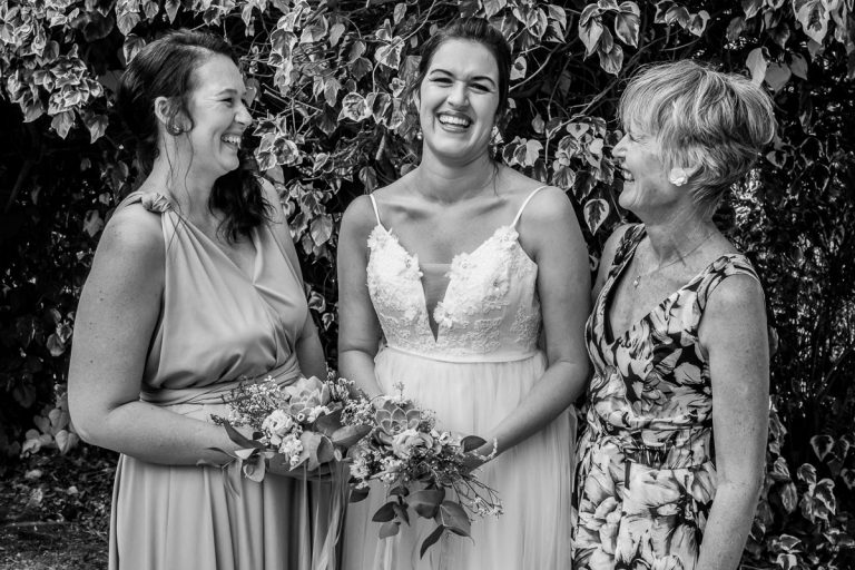 a fun wedding family portrait of the bride, her mom and sister