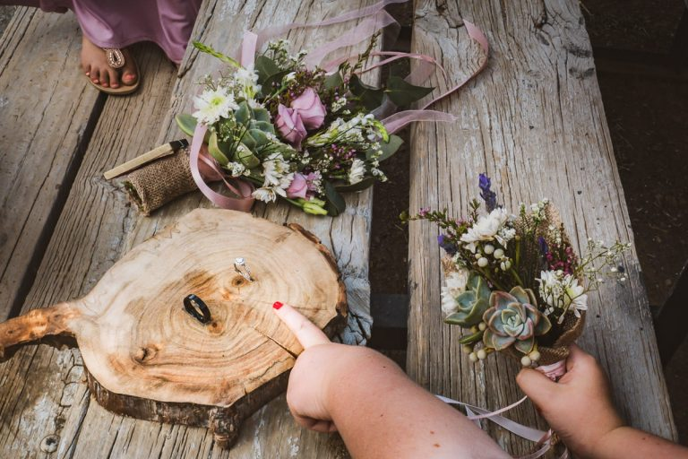 the flower girls point to the beautiful wedding rings