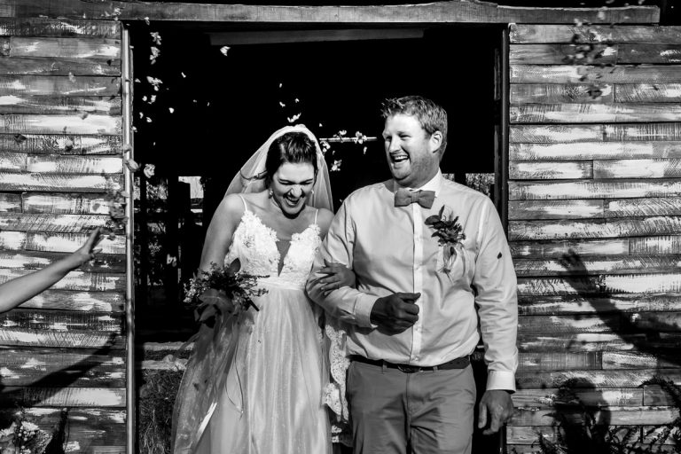 A Karoo Wedding of the bride and groom exiting their wedding reception