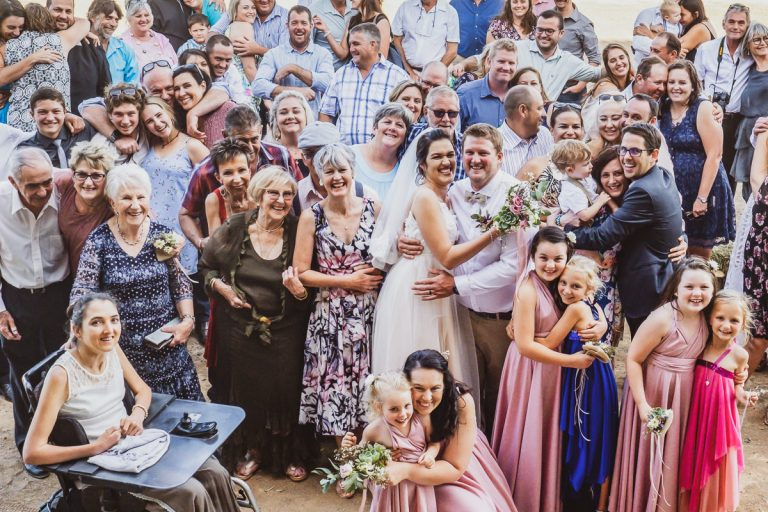 A Karoo Wedding with all the wedding guests sharing a warm hug