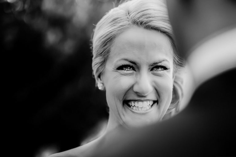 Beautiful Wedding Photos by Christelle Rall like this one of the bride looking at her groom during the wedding ceremony with tears in her eyes.