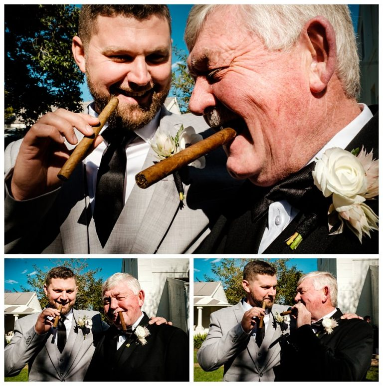 the groom and his father smoking a cigar