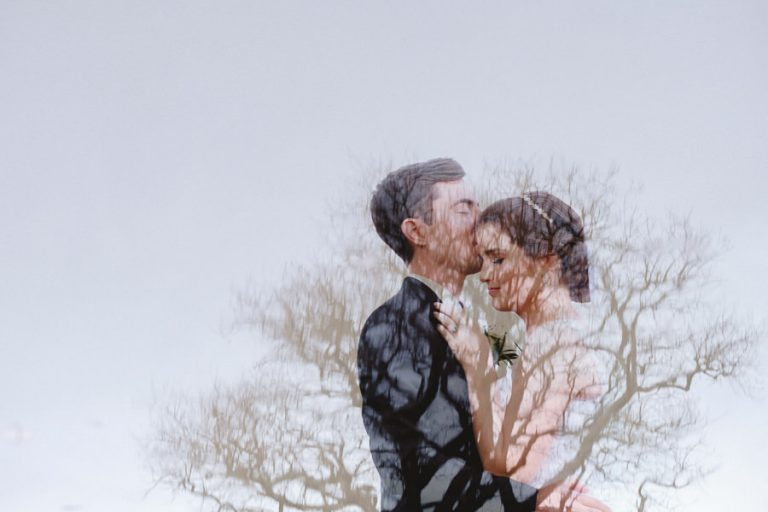 a creative Fancourt Hotel bride and groom portrait making use of photographic technique for this double exposure of the groom with a tree