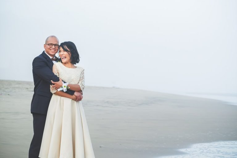 Intimate Wilderness Wedding like this soft beach wedding photo of bride and groom laughing