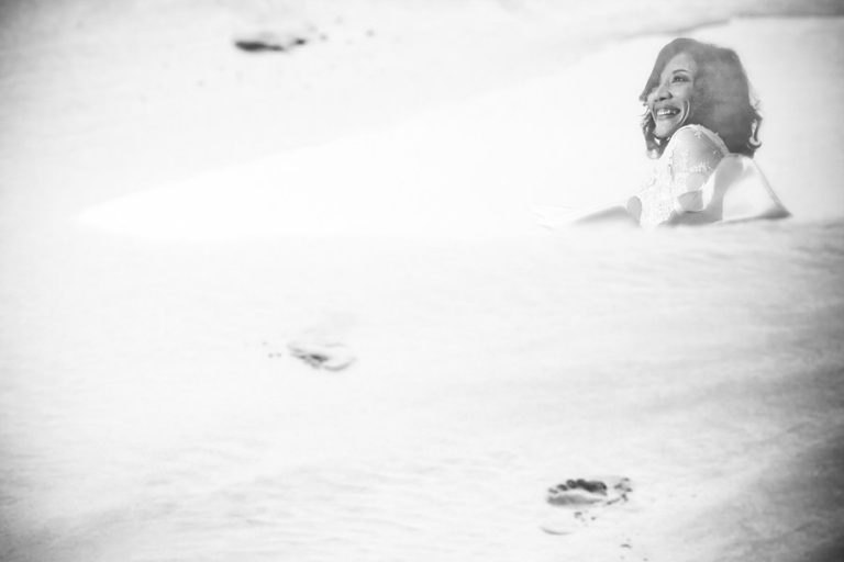 Intimate Wilderness Wedding with this creative bride portrait in the sand