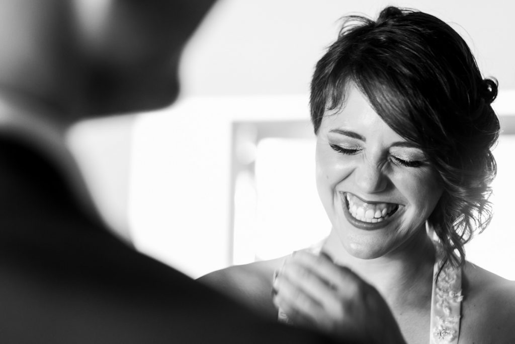The bride laughs for a personal joke during the wedding ceremony