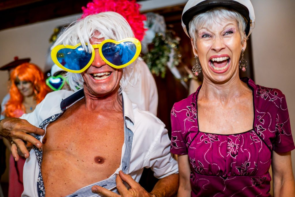 wedding guests enjoying the photo booth props