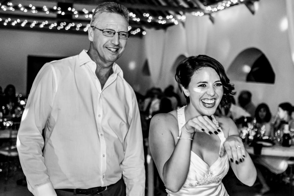 the bride and her father doing dance moves