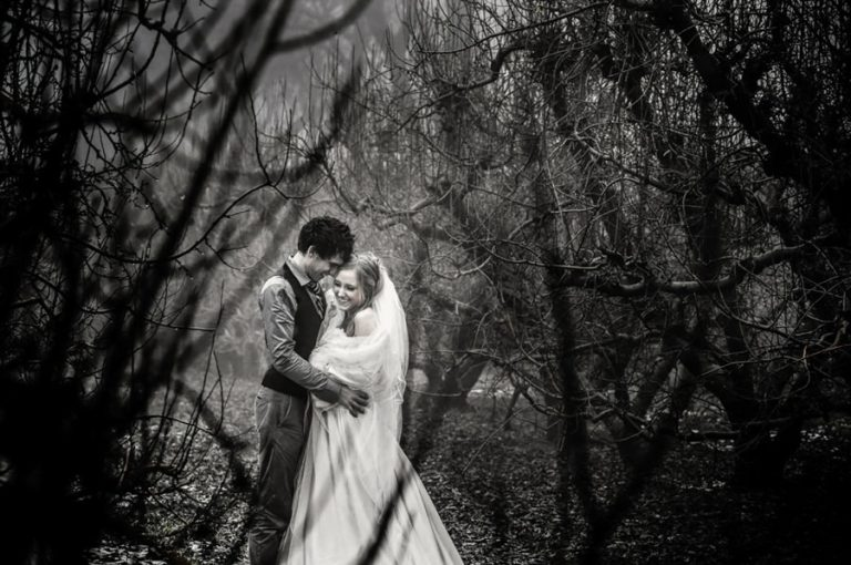 a fine photo of the bride and groom in the mist in an orchard