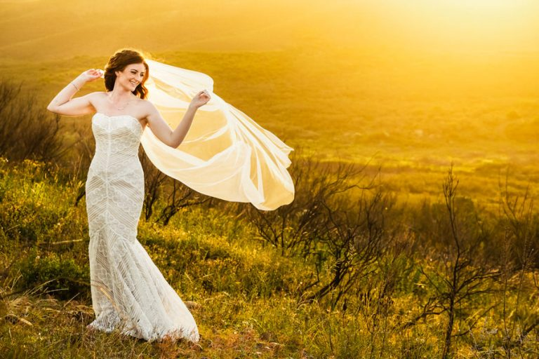 a photo of bride in the wind using beautiful soft sunset light