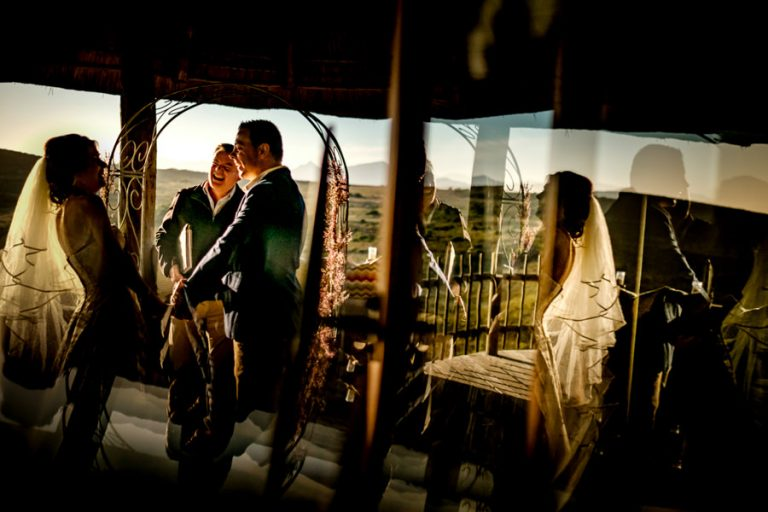 a comical moment during the wedding ceremony using reflections