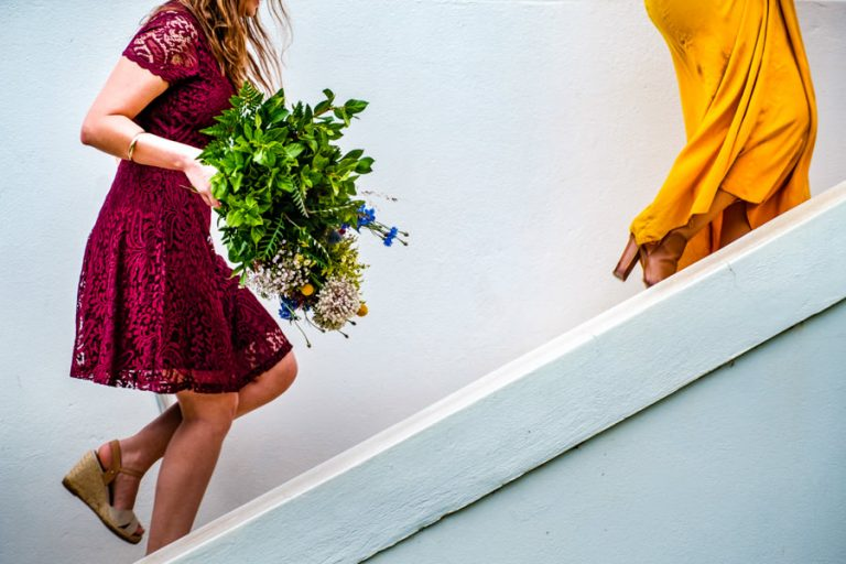 a colourful photo of the wedding guests walking up the stairs