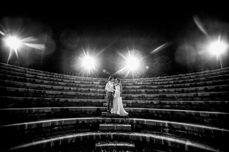 a night photo of the bride and groom on stairs