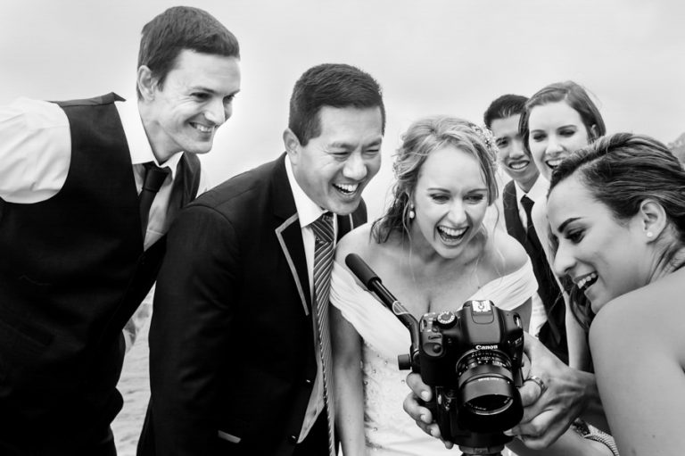 the bridal couple react to a comical moment on video