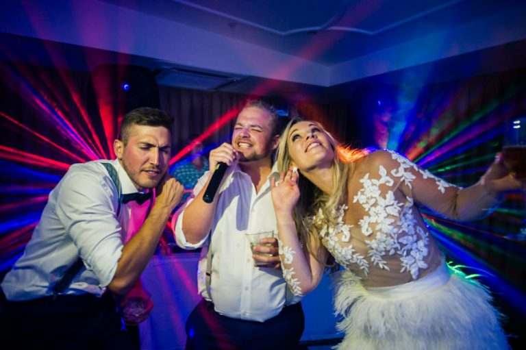 the newlyweds doing a song with wedding guest