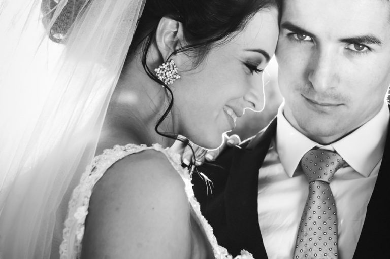 a black and white close up photo of the bride and groom