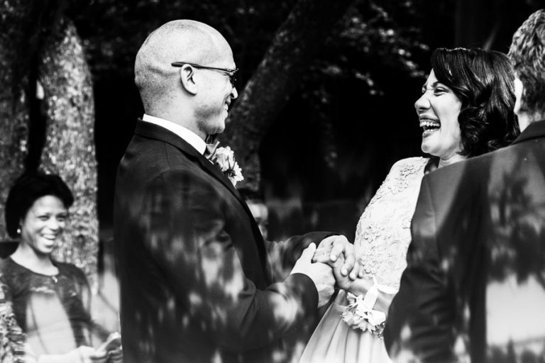 the fun moment between bride and groom at the wedding ceremony