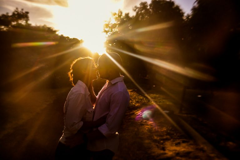 sunset streaks for this kissing engagement photo