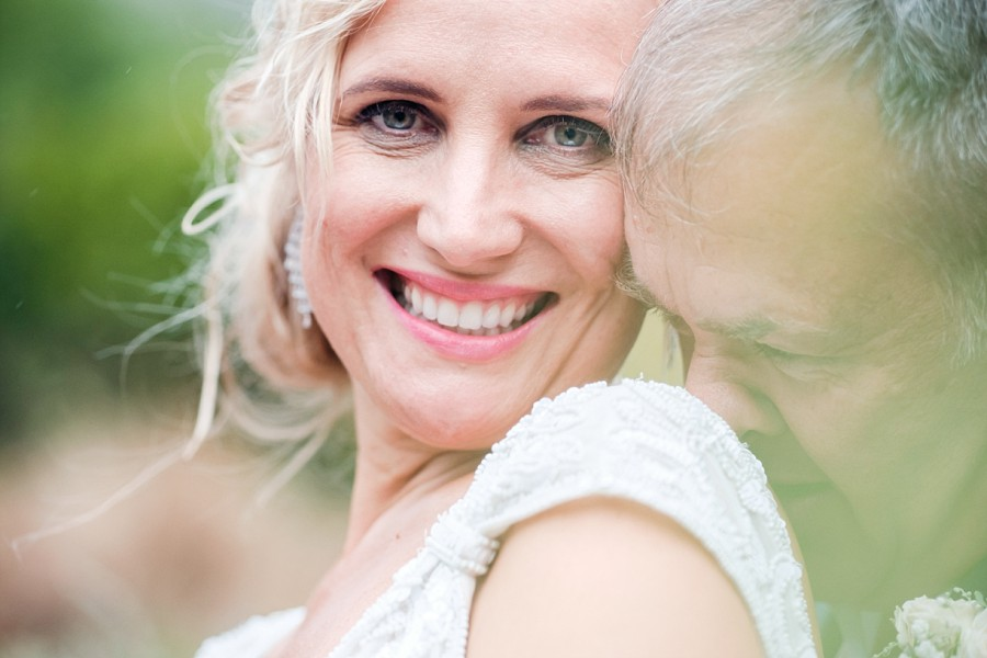 a romantic close up of the bride smiling
