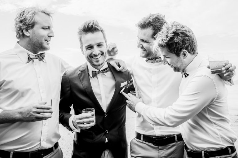 the groom and his groomsmen having a fun moment