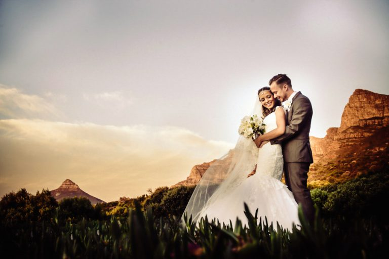 a sweet moment between newlyweds with beautiful mountains in the background