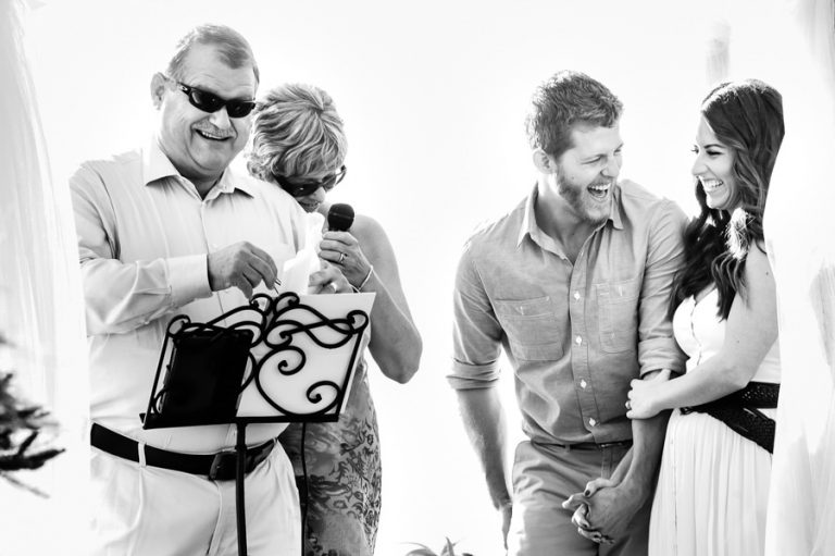 a funny moment between parents and wedding couple during the ceremony