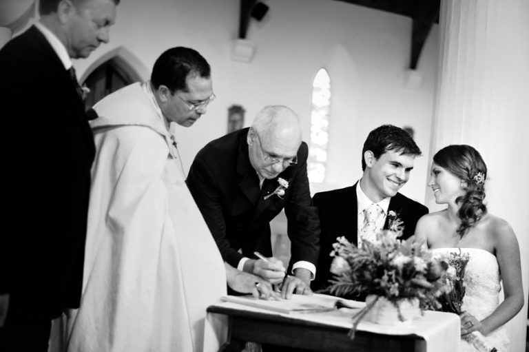 a loving moment between the newlyweds while signing the register