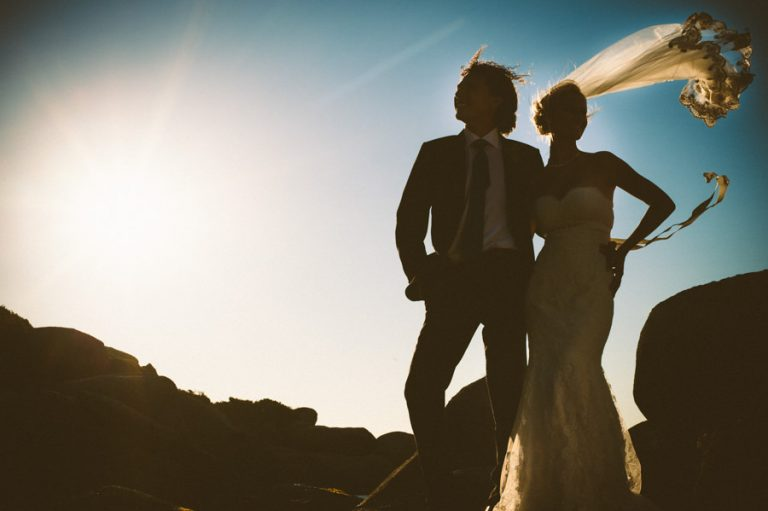 a creative wedding photo of the bride's veil in the wind