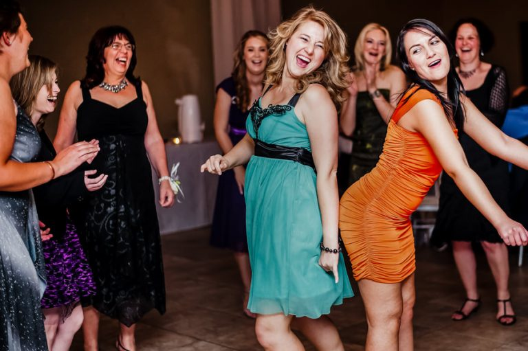 the wedding guests having fun on the dance floor