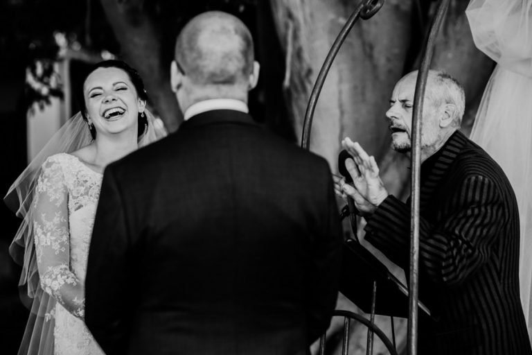 a comical moment with the efficient and bride during the moment