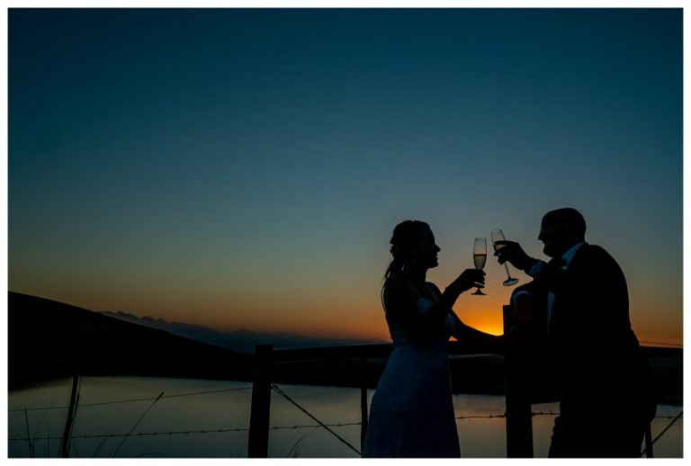 a silhouette photos of the wedding couple and a Champaign