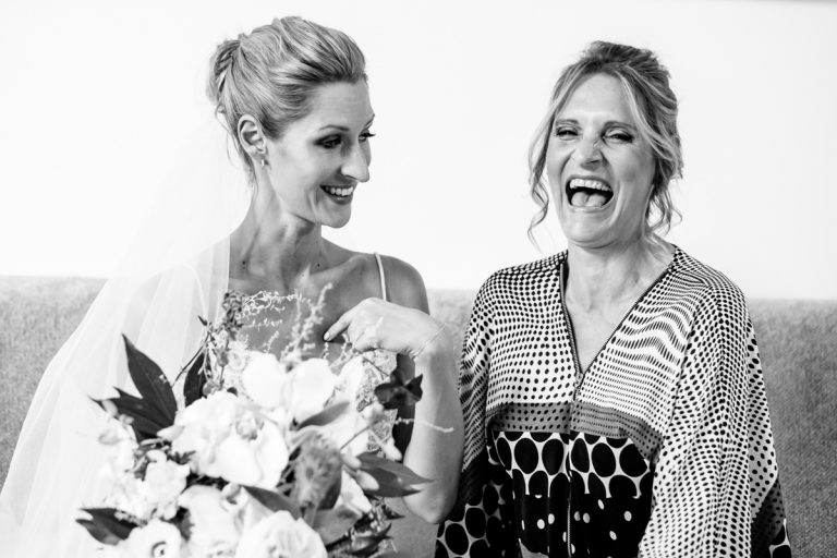 the bride and her mom sharing a funny moment