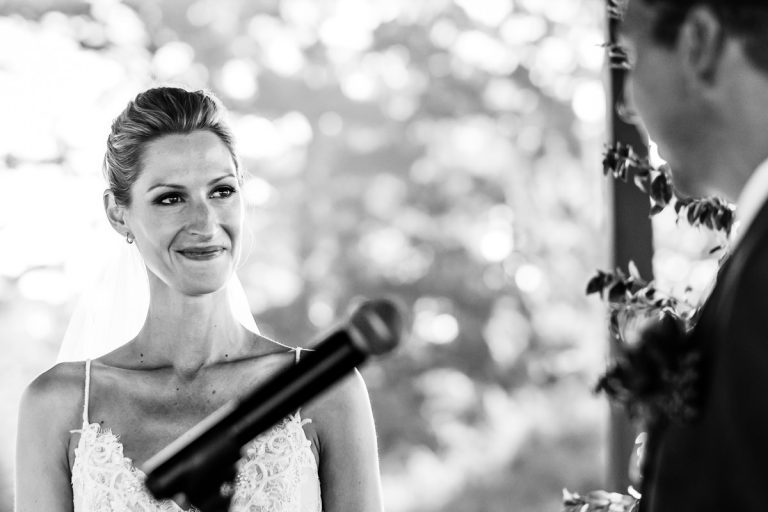 the bride gets emotional during the wedding ceremony