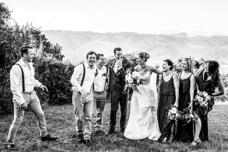 the bridal party shares a comical moment