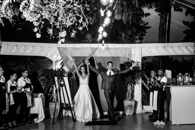 the bride and groom enter their wedding reception to Thunder by ACDC