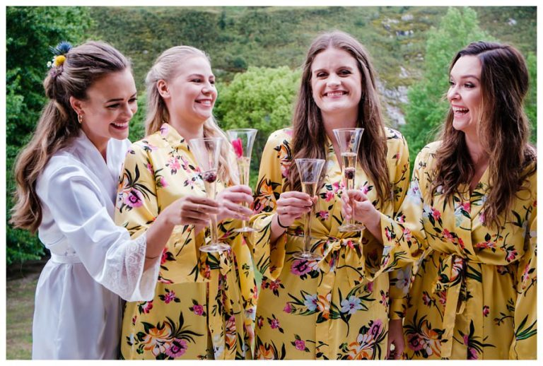 the bride and her bridesmaids makes a toast