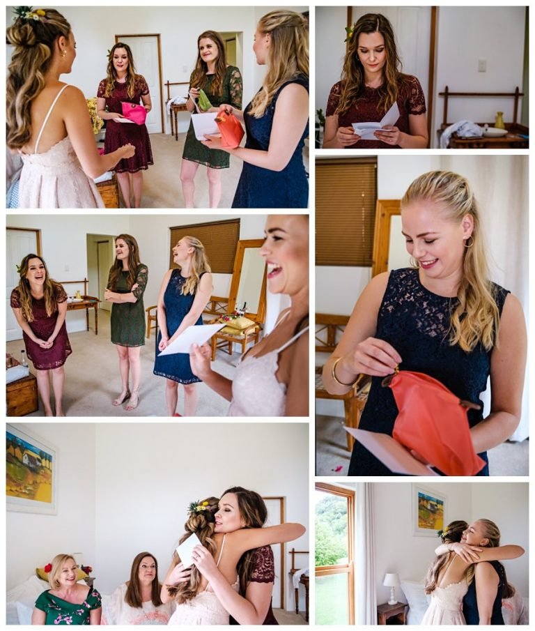 the bride handing out gifts to her bridesmaids