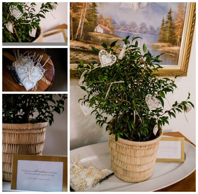 the wedding guest book with notes on a plant