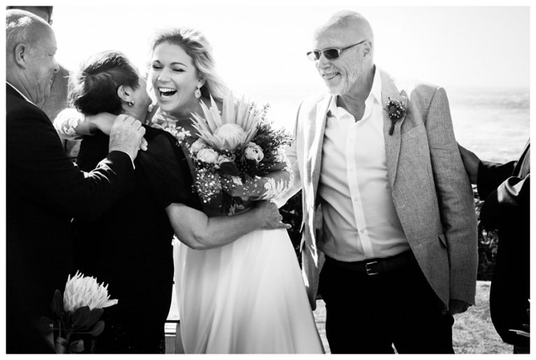 the bride giving a guest a hug at a Wedding at Twelve Apostles hotel