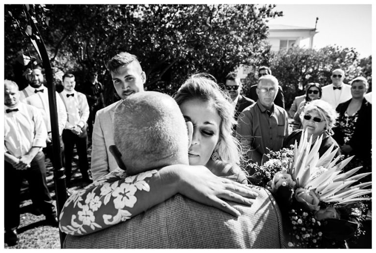 the bride hugs her father at a Wedding at Twelve Apostles hotel
