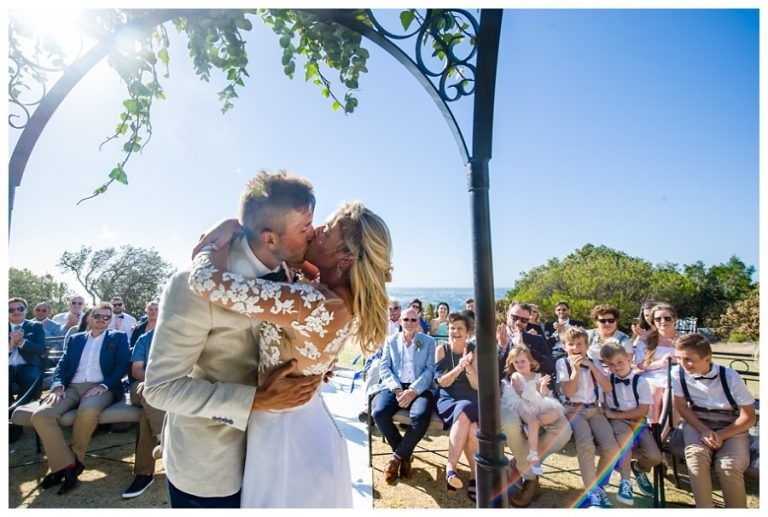 The first kiss for a ceremony for this Wedding at Twelve Apostles hotel
