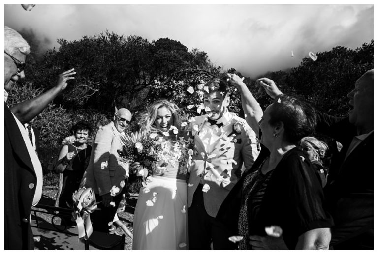 The bride and groom showered with rose petals at their Wedding at Twelve Apostles hotel