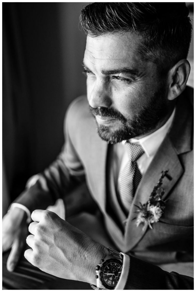 a black and white groom portrait