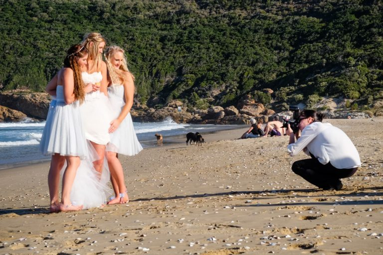 Robberg beach photo of a bride and her bridesmaids in Plettenberg Bay