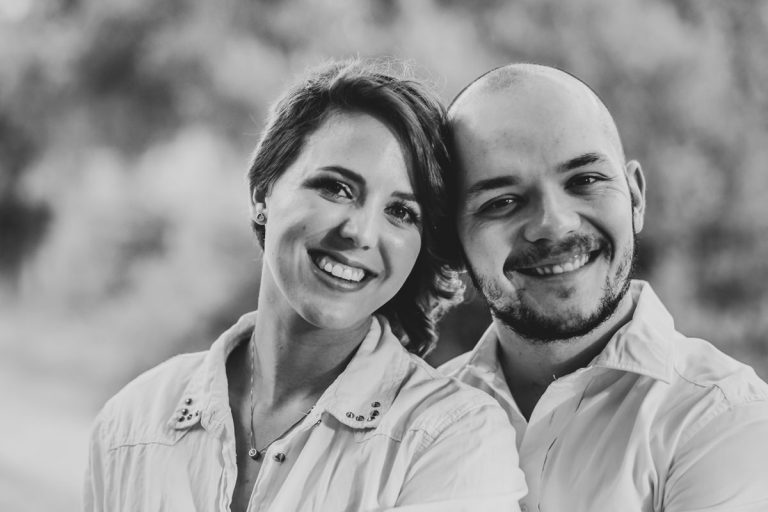 A sweet black and white portrait of an engaged couple