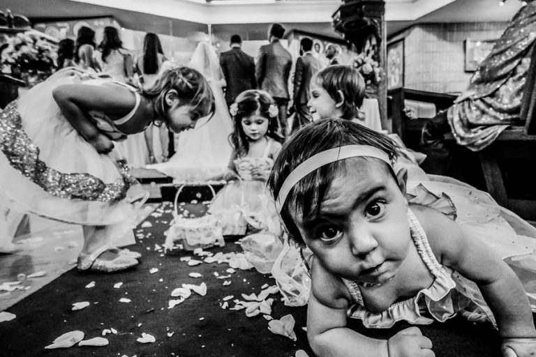 A documentary ceremony shot of kids while the couple are getting married