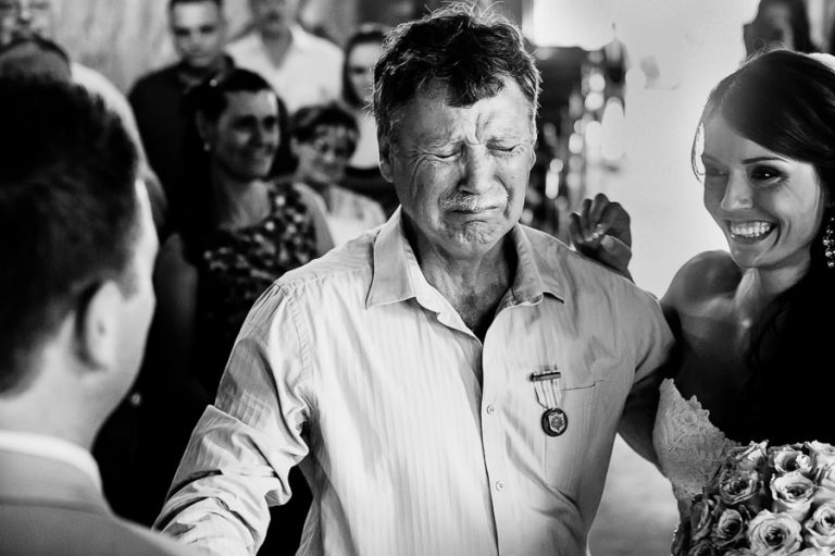 Father of the bride's emotional farewell to his daughter is captured in a split second moment