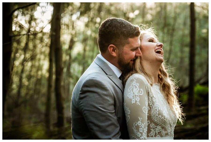 the couple shares a funny moment for this natural wedding portrait
