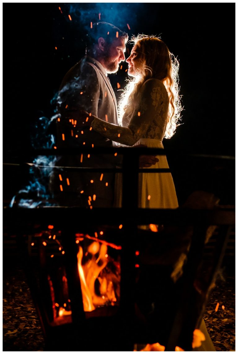 a creative night wedding portrait of the bride and groom